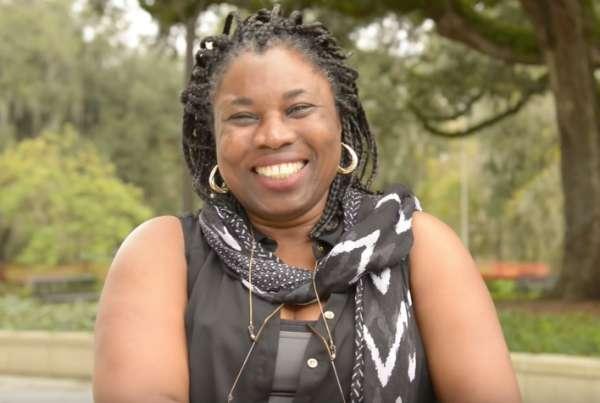 Mavis Agbandje-McKenna smiling outdoors in a garden