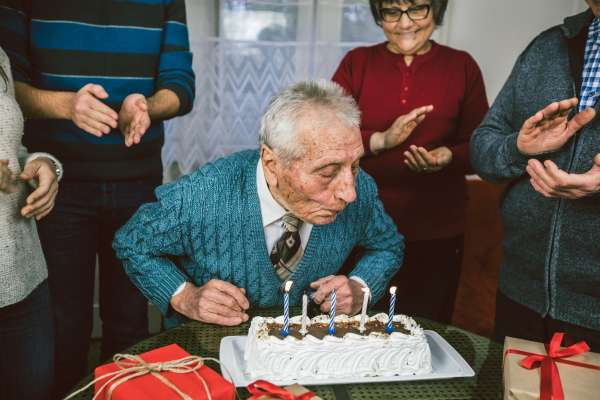 a grandfather celebrates his birthday with family.