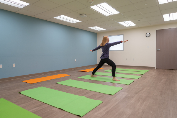 Woman doing yoga in an empty room