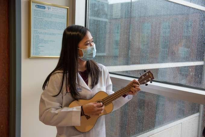 Aprinda playing ukelele