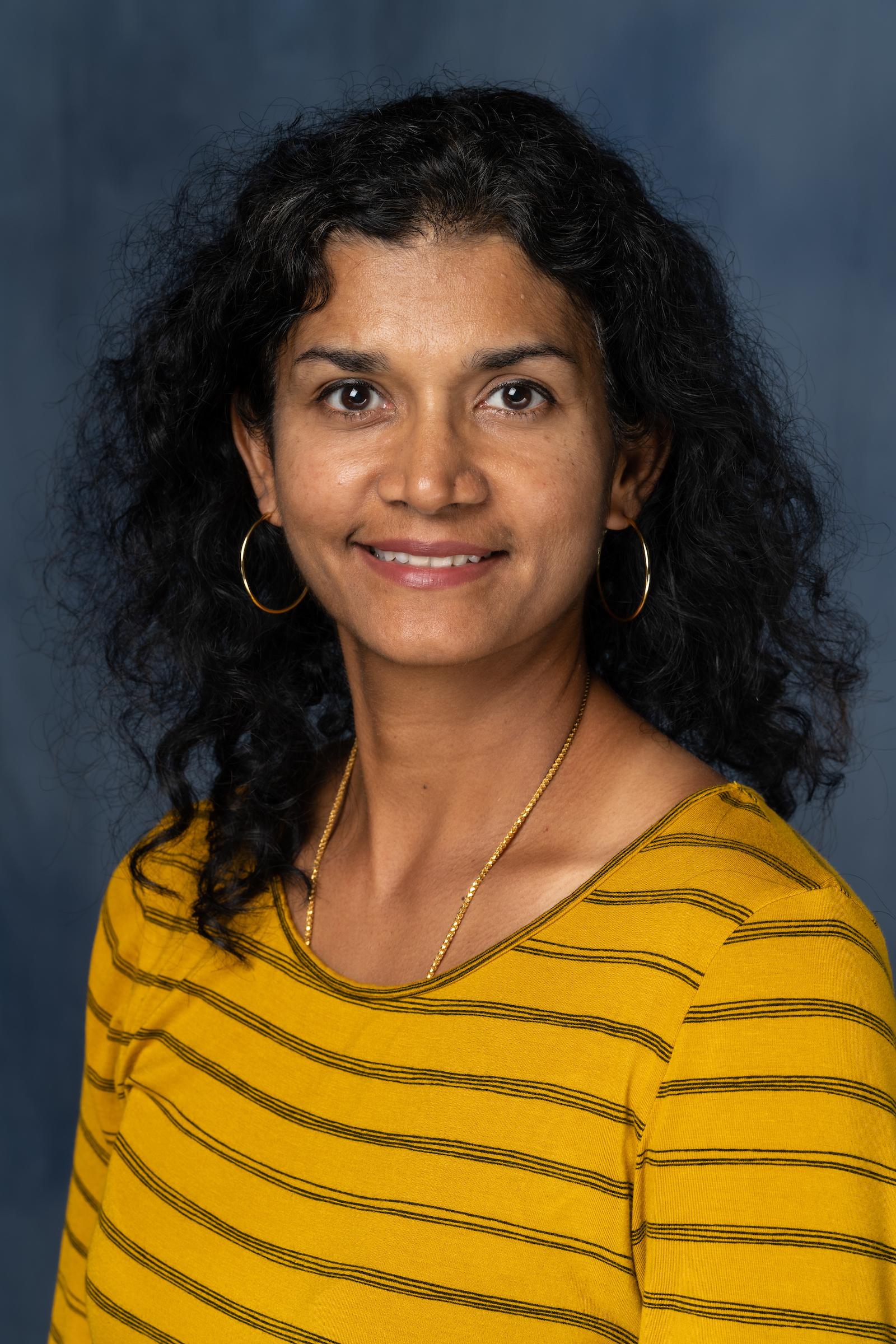 posed headshot of Vedam-Mai